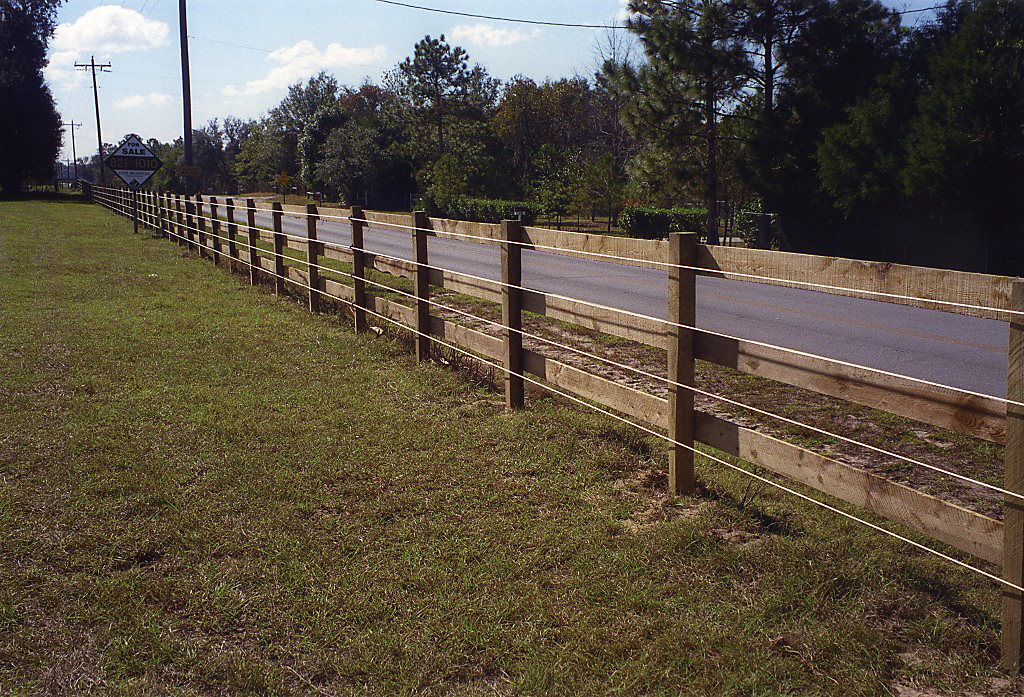 Electric Fence with Wood Rail Fence